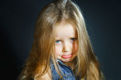 Cute little girl with long hair close-up portrait Stock Photo