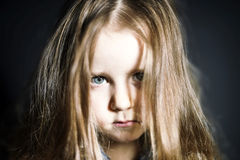 Cute little girl with long hair close-up portrait Stock Image
