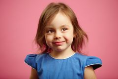 Cute little girl is looking above the camera with a wistful glance. royalty free stock photography