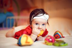 Adorable girl on the bed. Cute little girl looking at camera and crawling on the bed at home stock image