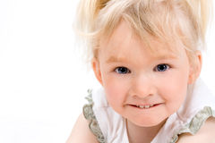 Cute little girl looking at the camera Royalty Free Stock Photography