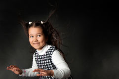 Cute little girl looking clever Royalty Free Stock Photos