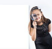 Cute  little girl looking through a magnifying glass. Educational concept Royalty Free Stock Photography