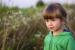 Cute little girl looking seriously ahead Royalty Free Stock Photos