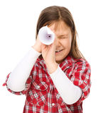 Cute little girl is looking through spyglass Stock Images