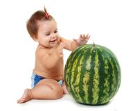 Cute little girl looking to watermelon Royalty Free Stock Photos