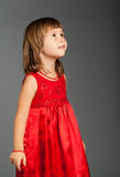 Cute little girl looking up Stock Photo