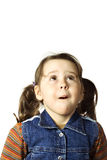 Cute little girl looking up with surprise. On white Royalty Free Stock Image