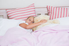 Cute little girl lying in bed Royalty Free Stock Image