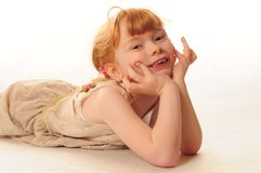 Cute little girl lying on floor Royalty Free Stock Photography