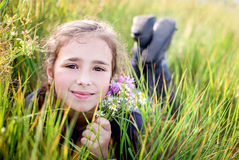 Cute little girl lying on the grass Royalty Free Stock Images