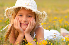 Cute little girl lying on the meadow on sunny day Stock Photography