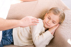 Cute little girl lying on the sofa Stock Photo