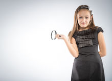 Cute  little girl with magnifying glass in hands. Educational concept Stock Image
