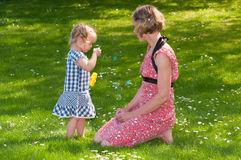 Cute little girl makes soap bubbles Stock Photography