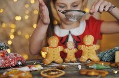 Free Cute Little Girl Makes Traditional Gingerbread Man. Royalty Free Stock Photography - 168070677