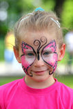 Cute little girl with makeup. Painted face stock image