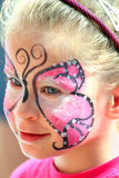 Cute little girl with makeup. Painted face Royalty Free Stock Image