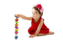 Cute little girl making from plasticine box,  on white Stock Images