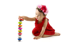 Cute little girl making from plasticine box,  on white Royalty Free Stock Image