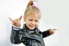 Cute little girl. Making a rock-n-roll sign Royalty Free Stock Image