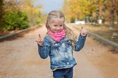 Cute little girl making a rock-n-roll sign Stock Photos