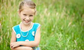 Cute little girl  on the meadow Royalty Free Stock Image