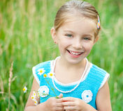 Cute little girl  on the meadow Royalty Free Stock Photo