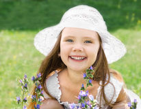 Cute little girl on the meadow with flowers Stock Photography