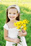 Cute little girl on the meadow with flowers Royalty Free Stock Photography