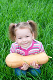 Cute little girl on the meadow with pumpkin Royalty Free Stock Image