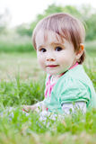 Cute little girl on the meadow. Cute little girl on the meadow in spring day Stock Photos