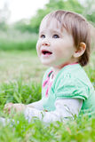 Cute little girl on the meadow. Cute little girl on the meadow in spring day Royalty Free Stock Photos
