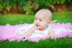 Cute little girl on the meadow in spring day Royalty Free Stock Image