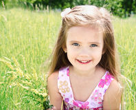 Cute little girl on the meadow Stock Photography