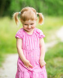 Cute little girl on the meadow Stock Images