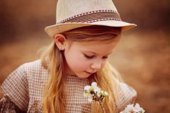 Cute little girl on the meadow in summer day stock image
