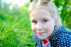 Cute little girl on the meadow in summer day. In park Stock Photography