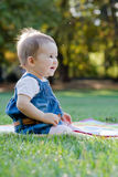 Cute little girl on the meadow. Cute little girl on the meadow with sunset Royalty Free Stock Images