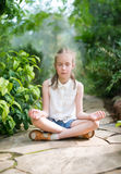 Cute little girl meditating. Royalty Free Stock Photos