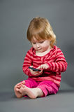 Cute little girl with mobile phone royalty free stock photos