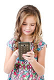 Cute little girl with mobile phone isolated on a white Royalty Free Stock Photography