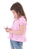 Cute little girl with modern smart phone isolated on white Royalty Free Stock Image