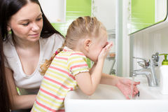 Cute little girl with mom washing in bath Stock Photo