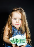 Cute little girl with money euro in her hand. Stock Photography