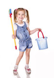 Cute little girl with mop and bucket is ready to clean Royalty Free Stock Image