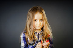 Cute little girl with mother's cosmetics, close-up portrait Royalty Free Stock Images