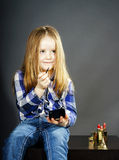 Cute little girl with mother's cosmetics, close-up portrait Royalty Free Stock Image