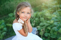 Cute little girl on nature in summer day Stock Photo