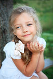 Cute little girl on nature in summer day Stock Photos